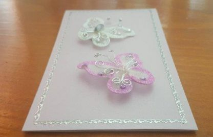 A handmade, Unisex Pink & White Butterfly Card